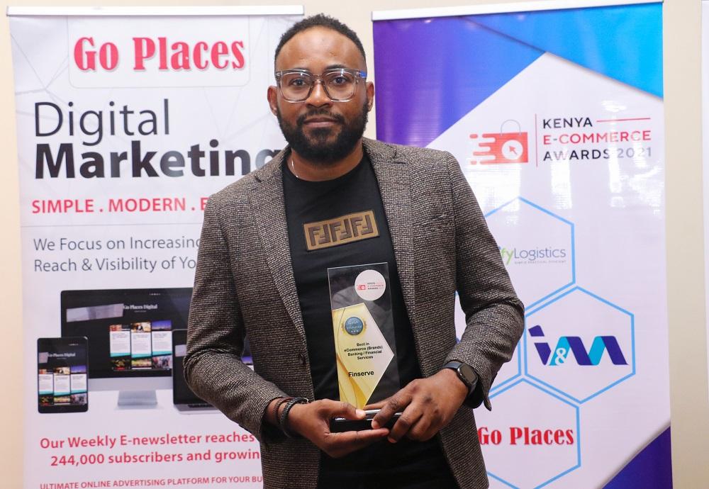 Finserve Africa Managing Director Lanre Bamisebi poses with the Gold trophy